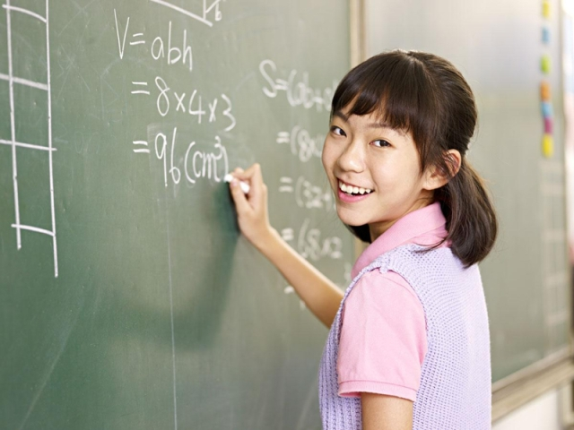 Asian student at chalkboard