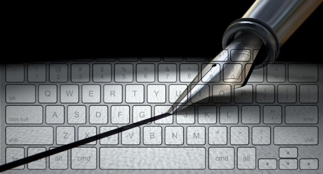 Image of pen writing across keyboard